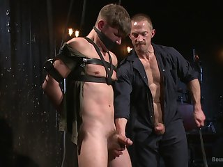 Gagged gay lad enjoys senior male of a wild BDSM