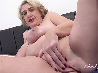 Camilla is a big titted mature who doesn't mind masturbating in front be advisable for the camera