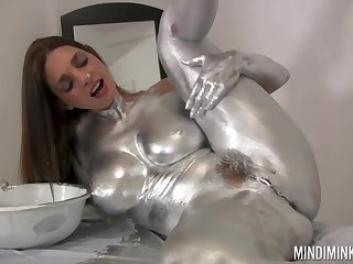 Nude knockout covers herself in silver paint of a kinky simply