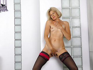 Small tits blondie Diana Gold less stockings and on one's high horse heels masturbating