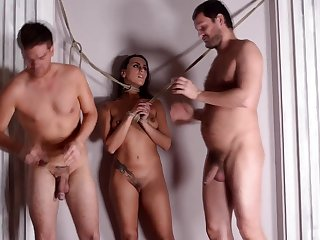 Pornstar Mia Melone tied up and fucked in all holes by two dudes